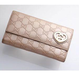Authentic Gucci Guccissima Leather Bi-gold Wallet